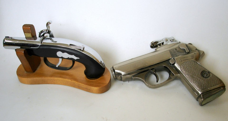 VINTAGE GUN CIGARETTE LIGHTERS. HANDGUN AND CHROME DERRINGER ON A